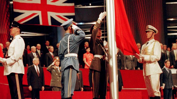 The Chinese flag is raised by People's Liberation Army soldiers to signal Hong Kong's return to Chinese sovereignty after 156 years of British rule in Hong Kong on July 1, 1997.