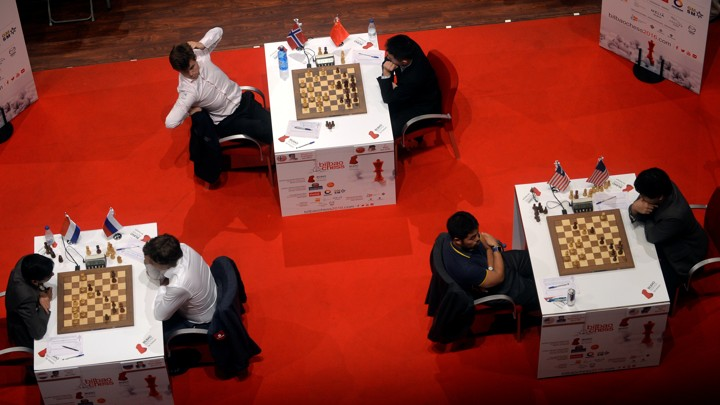 Three games of chess are observed from overhead