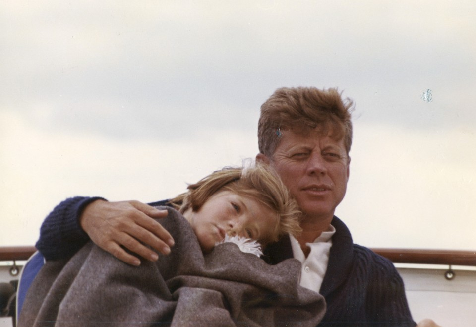 President John F. Kennedy sits on a yacht with his daughter Caroline off Hyannis Port, Massachusetts, in August 1963.