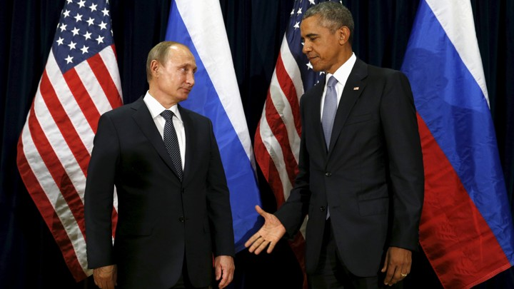 President Barack Obama extends his hand to Russian President Vladimir Putin during their meeting at the United Nations General Assembly in New York on September 28, 2015.