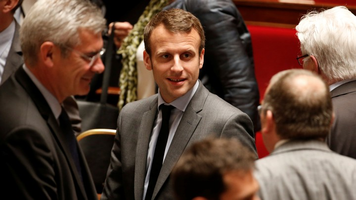 Emmanuel Macron leaves after the government session at the National Assembly in Paris, France, on May 10, 2016.