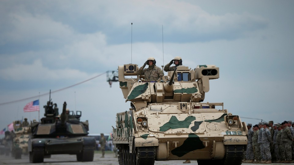 U.S. servicemen drive their armored vehicles during a joint military exercise on May 11, 2016.