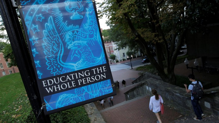 "A sign on the Georgetown University campus reads ""The Spirit of Georgetown: Education the whole person"""