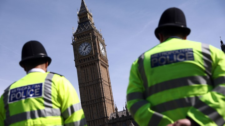 Police officers patrol in Parliament Square following an attack in central London onMarch 26, 2017.