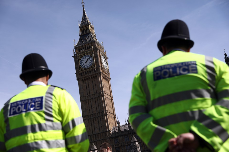 Police officers patrol in Parliament Square following an attack in central London on March 26, 2017.