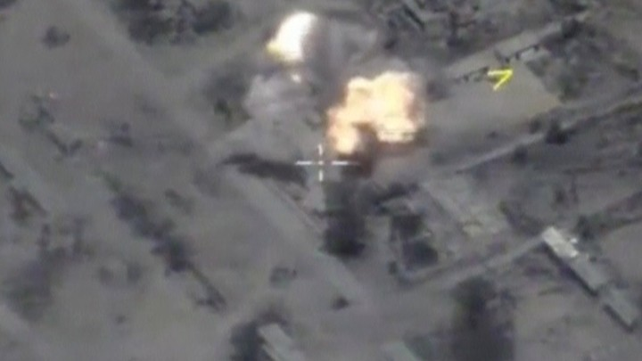 Russian bombs hit ISIS targets near the Syrian city of Palmyra in late May.
