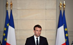 French President Emmanuel Macron attends a press conference.
