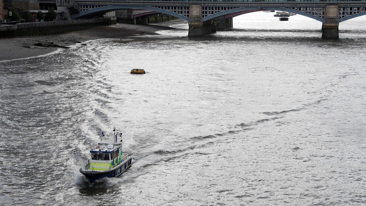 A police boat drives along the River Thames towards the London Bridge on June 6, 2017.