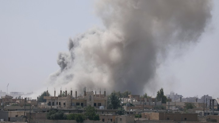 Smoke rises from the al-Mishlab district at Raqqa's southeastern outskirts.