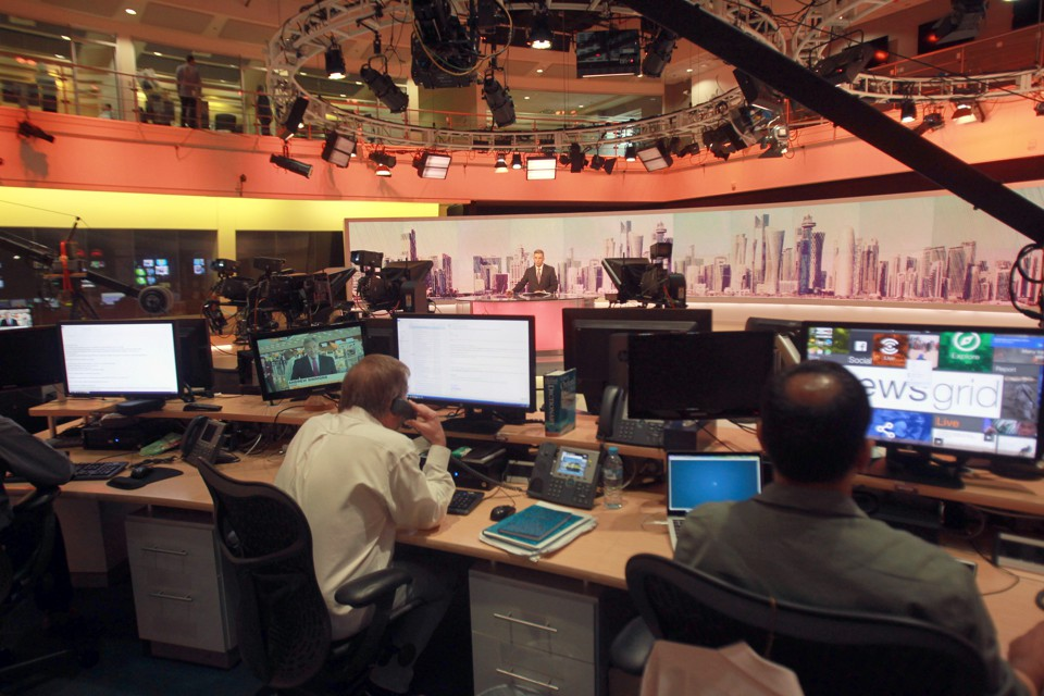 Staff work inside the headquarters of Al Jazeera Media Network in Doha, Qatar, on June 8, 2017.