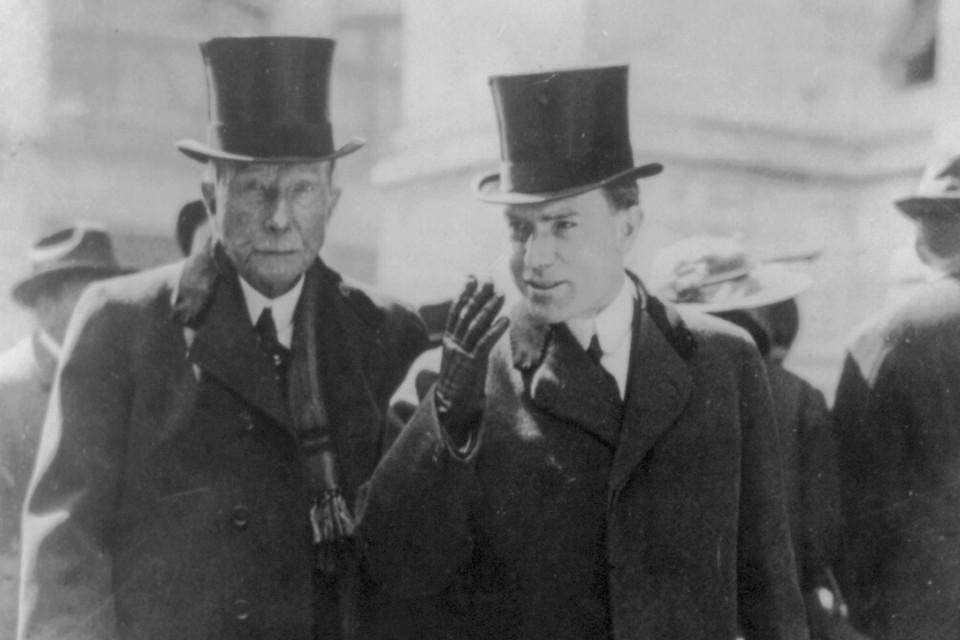 John D. Rockefeller, left, with his son, circa 1915