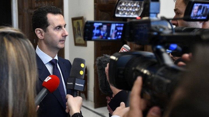 Syrian President Bashar al-Assad speaks with French journalists in Damascus on January 9.