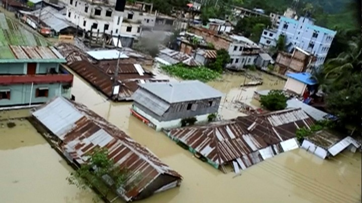 An aerial view shows Khagrachari, Bangladesh half-submerged in floodwaters following landslides triggered by heavy rain.
