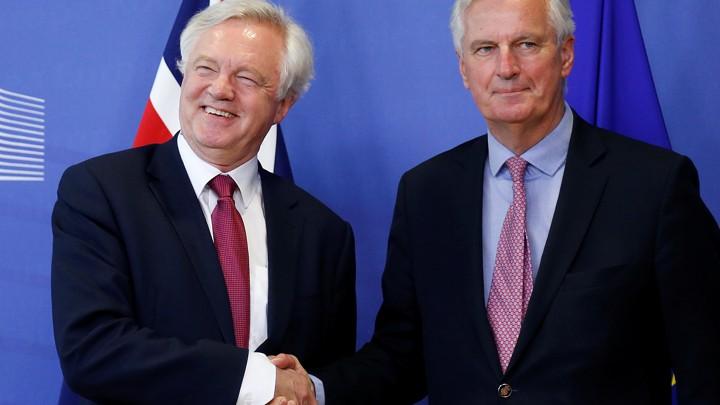 The EU's chief Brexit negotiator, Michael Barnier, welcomes the UK's Brexit secretary, David Davis.