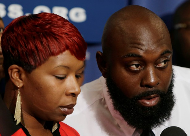 Brown's parents appear at a news conference at the National Press Club in Washington on September 25, 2014.