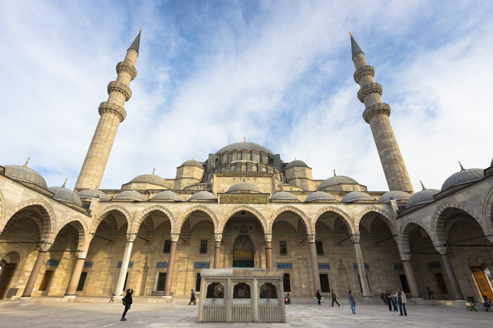 Tourists explore the courtyard of Suleymaniye Mosque in Istanbul.