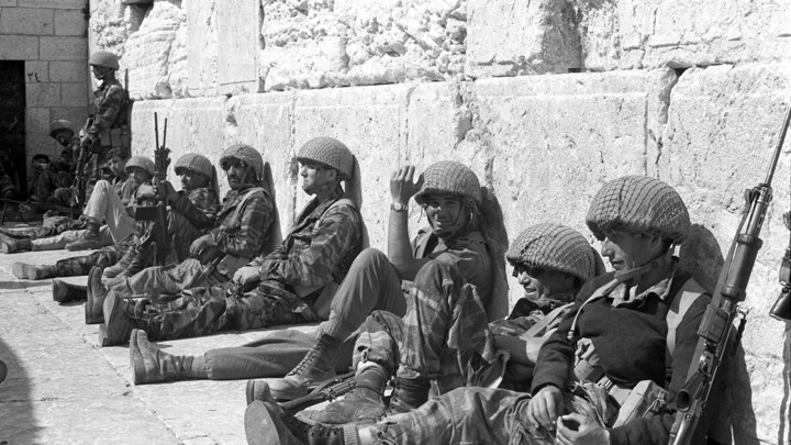 Israeli soldiers sit in front of the Western Wall in Jerusalem's Old City.