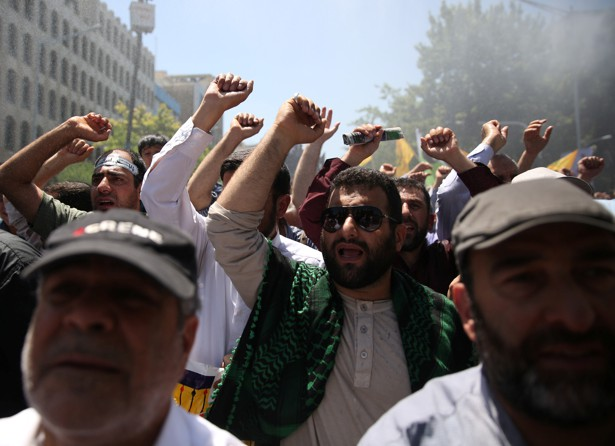 People attend a funeral for the victims of the June 7 attacks in Tehran.