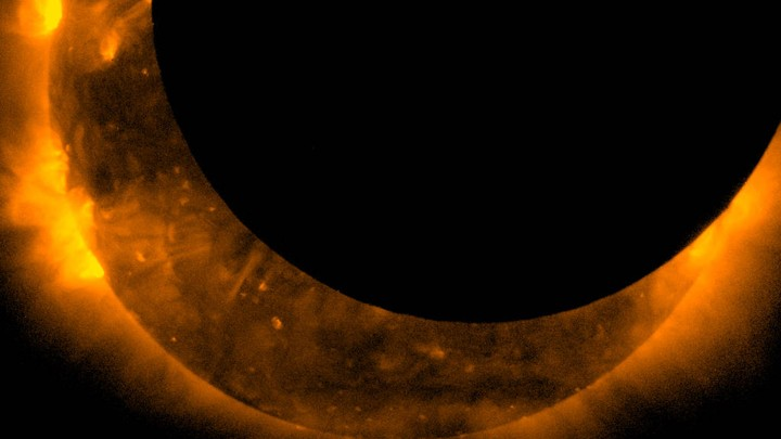 The view of a 2012 solar eclipse from the Hinode spacecraft