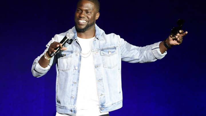 Kevin Hart performs during a comedy show.