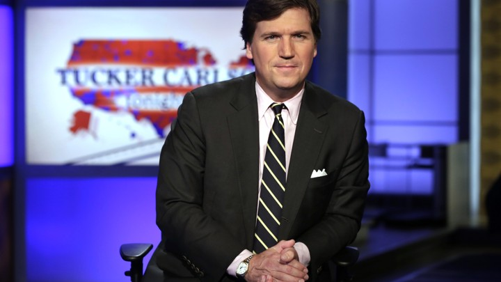 "Tucker Carlson, host of ""Tucker Carlson Tonight,"" looks at the camera."