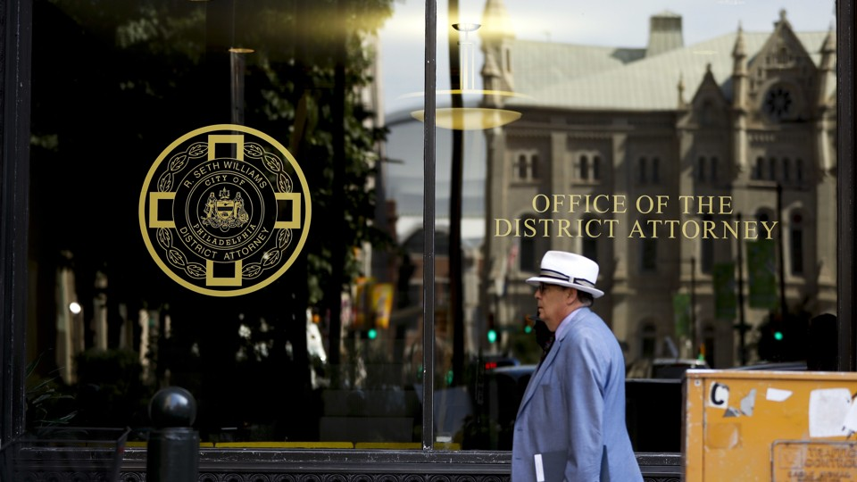 A man walks by the district attorney's office in Philadelphia