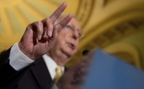 Senate Majority Leader Mitch McConnell gestures while speaking at a July news conference on Capitol Hill.