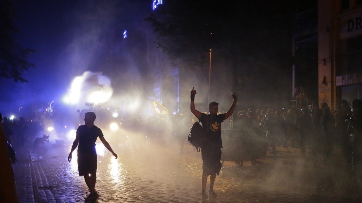 Police use water cannons against protesters on July 6, 2017.