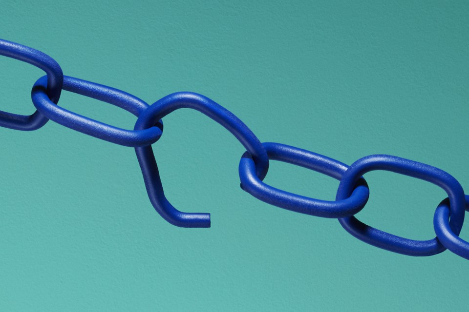 A dark blue chain with one broken link against a light blue background