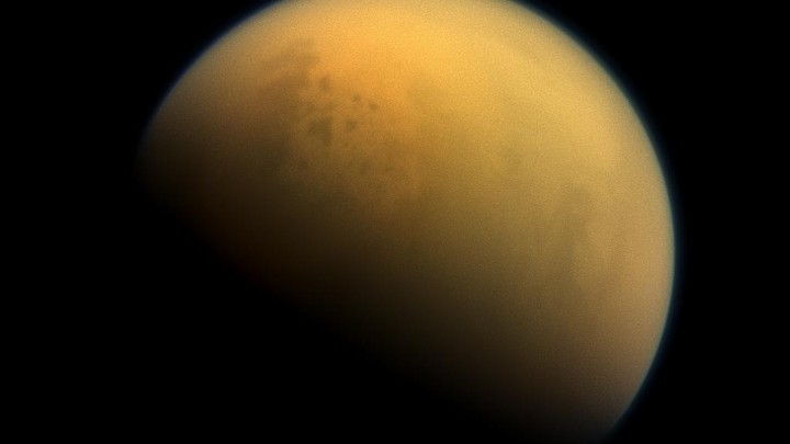 Titan, Saturn's largest moon, has a thick atmosphere teeming with organic compounds.