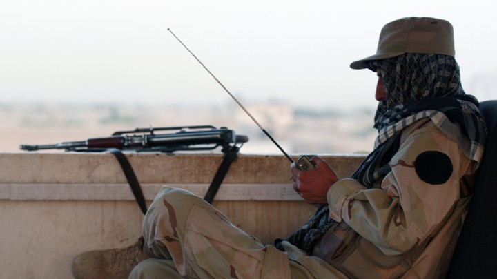 A private security organization contractor listens to a radio during his duty at guard tower in Camp Nathan Smith in Kandahar City May 7, 2010.