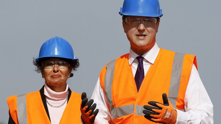 Anne Marie Morris stands alongside former Prime Minister David Cameron in Devon, England on April 10, 2015.
