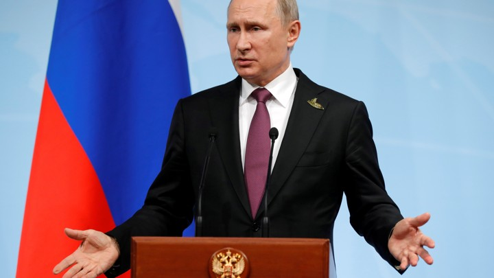 Russian President Vladimir Putin speaks during a news conference after the G20 summit.