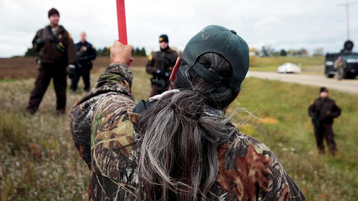 Michael Markus of Pine Ridge Indian Reservation in South Dakota with police at a rally against the Dakota Access pipeline in October.