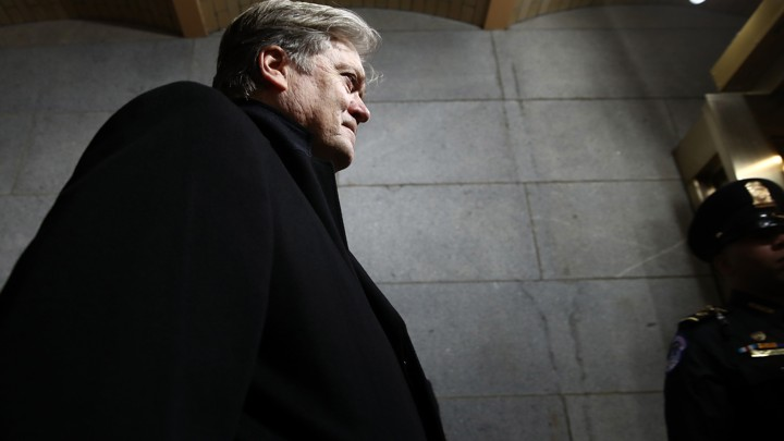 Steve Bannon walks up the stairs of the west front of the U.S. Capitol.