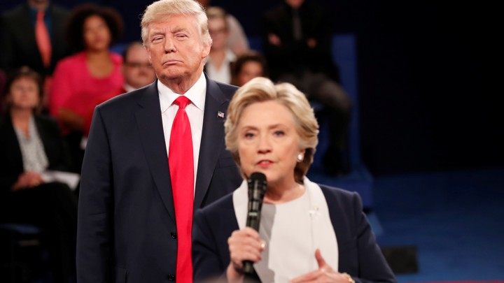 Donald Trump watches Hillary Clinton during a 2016 presidential debate.