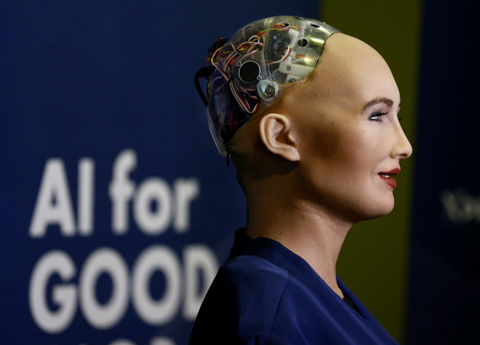A humanoid robot with wires exposed at the back of the skull
