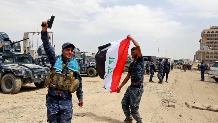 Iraqi Federal Police celebrate in the Old City of Mosul.