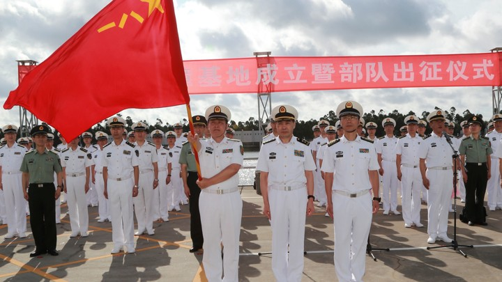 People's Liberation Army soldiers stand guard at a military port in Zhanjiang, Guangdong province, on July 11.