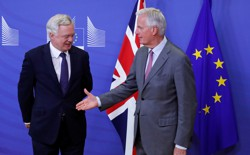 Michel Barnier, the European Commission Chief Brexit Negotiator, stands alongside David Davis, the U.K. Secretary of State for Exiting the European Union, at the resumption of Brexit talks in Brussels, Belgium on July 17, 2017.