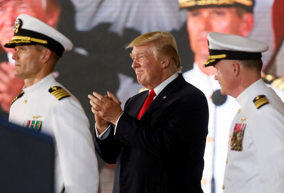 President Donald Trump stands with military personnel