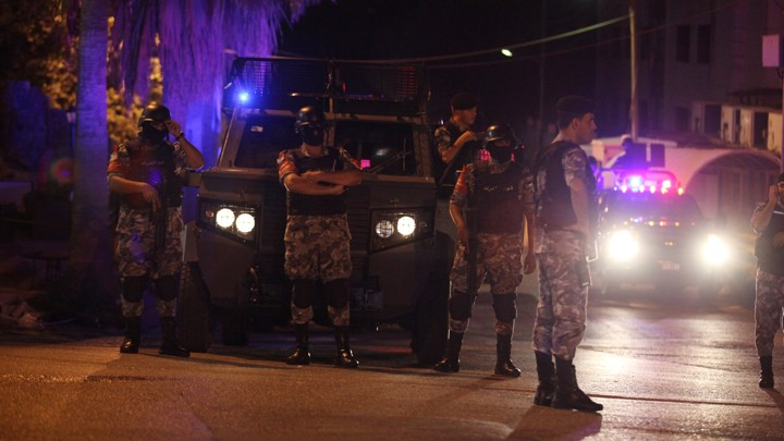 Policemen are seen near the Israeli embassy in Amman.