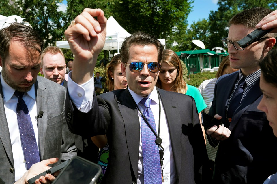Anthony Scaramucci surrounded by reporters