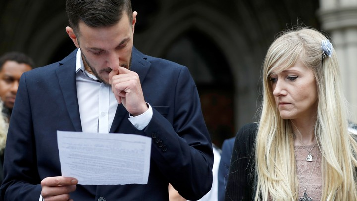 Charlie Gard's parents, Connie Yates and Chris Gard, read a statement at the High Court in London on July 24.