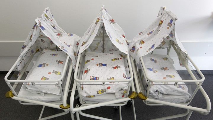 Empty cots are lined up for newborns at a Munich hospital in 2011.
