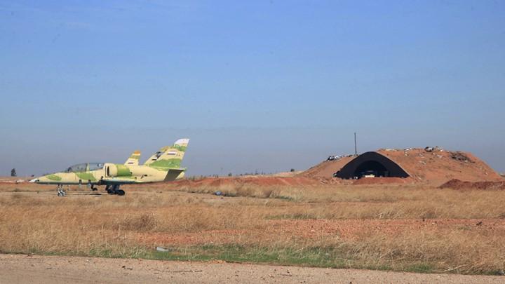 Warplanes inside the Kweiras air base, east of Aleppo, Syria.