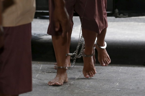 The legs of suspected human traffickers as they arrive for their trial in Bangkok on March 15, 2016