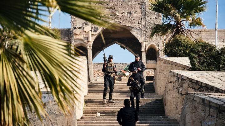 Members of the Iraqi special forces Counter Terrorism Service stand guard in front of Jonah's Tomb in Mosul on January 18, 2017.