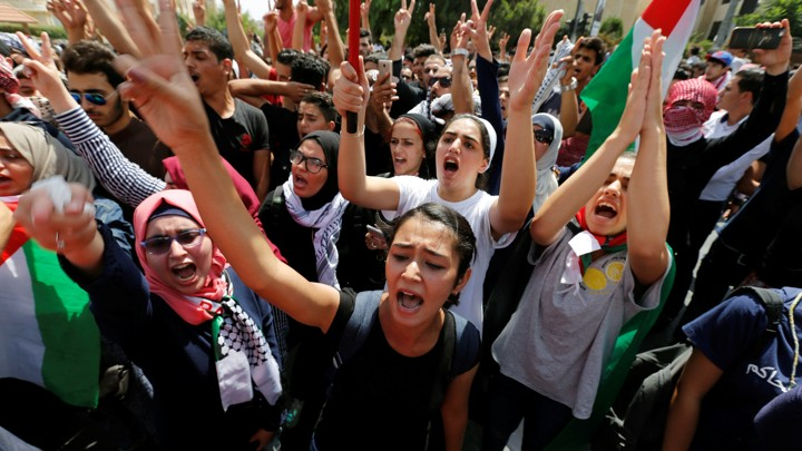 Protestors chanting slogans during a demonstration near the Israeli embassy in Amman.
