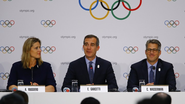 U.S. International Olympic Committee member Angela Ruggiero, L.A. Mayor Eric Garcetti, and Chairman of the L.A. 2024 Candidature Committee Casey Wasserman attend a briefing on July 11, 2017.